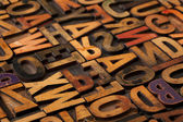 Alphabet abstract in vintage printing blocks — Stock Photo