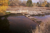 Water flowing into irrigation ditch — Stock Photo