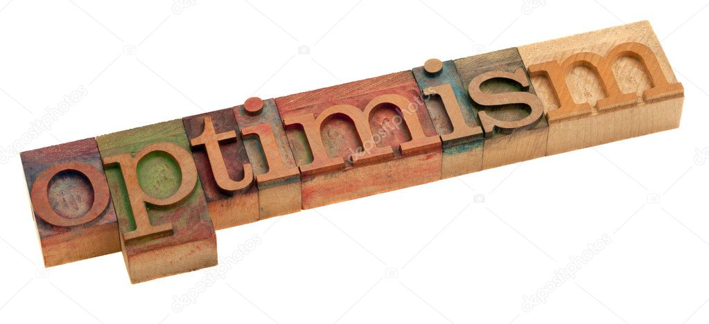 Optimism word in vintage wooden letterpress printing blocks, stained by color inks, isolated on white — Stock Photo #4414749