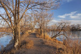Nature trail across lake area — Stock Photo