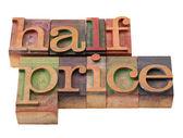 Half price - words in letterpress type — Stock Photo