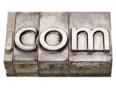 Dot com - internet domain in letterpress type — Stock Photo