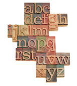 Alphabet abstract in wooden fonts — Stock Photo