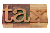 Tax word in wood fonts — Stock Photo