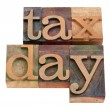 Tax day iwords in letterpress type — Stock Photo