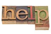 Help word in letterpress type — Stock Photo