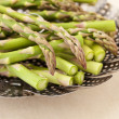 Stock Photo: Green asparagus in steamer basket