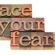 Face your fears phrase in letterpress type — Stock Photo