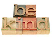 Be kind phrase in letterpress type — Stock Photo