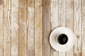 Coffee cup on grunge table — Stock Photo