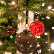 Christmas Balls Hanging From Christmas Tree - Stock Photo