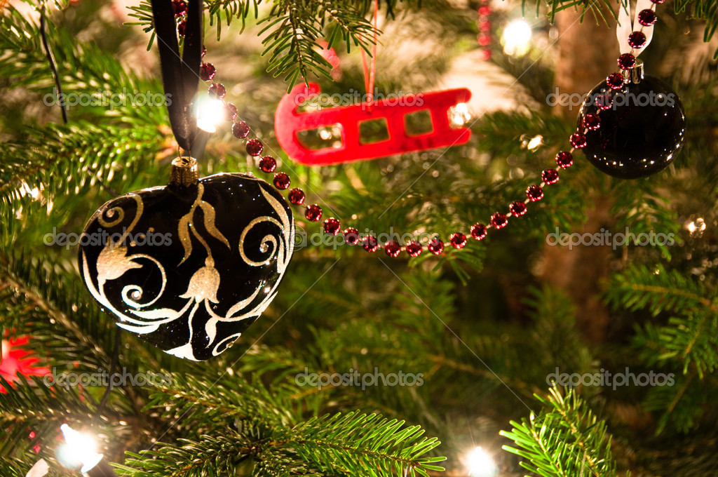 Various Christmas balls hanging from Christmas tee  Stock Photo #4541907