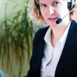 Business woman with laptop and headset — Stock Photo
