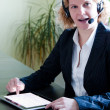 Business woman with digital tablet PC and headset — Stock Photo
