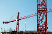 Construction site with cranes and building — Stock Photo