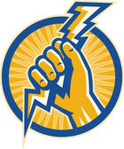 Hand hold a lightning bolt of electricity set inside a circle — Stock Photo