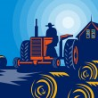 Farmer driving tractor hay bale farmhouse barn - Foto de Stock