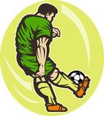 Jogador de futebol chutando a bola — Fotografia Stock