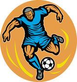 Topu tekmeleme futbolcu — Stok fotoğraf