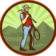 Miner carrying pick axe with mountains — Stock Photo