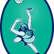 Netball player rebounding jumping for bal - Stock Photo