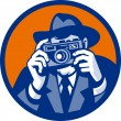 Stock Photo: Photographer with fedorhat aiming retro slr camera
