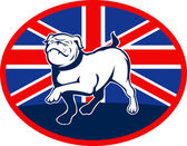 Proud English bulldog marching with British flag — Stock Photo
