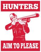 Hunter aiming a shotgun rifle front view — Stock Photo
