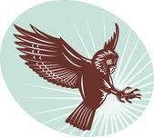 Owl swooping woodcut style — Stock Photo