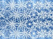 Witte sneeuwvlokken op blauwe achtergrond — Stockfoto