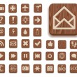 Dark wooden icon set with different signs — Stock Photo