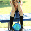 Young teen girl looking sad with soccer ball — Stock Photo #3940761