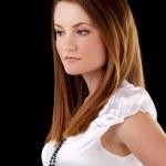 Somber caucasian woman white blouse against dark — Stock Photo #3940767