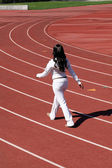 Young black woman walking sweat suit on track — Stock Photo