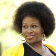 Middle-aged Black woman outdoors Portrait yellow jacket — Stock Photo