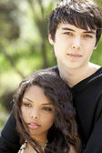 Outdoor portrait young teen caucasian male hispanic female — Stock Photo