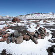 Stone circle and snow against mountain lake in Caucasus — 图库照片 #4039309