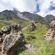 Rocks in Caucasus mountain valley with grass - Zdjęcie stockowe