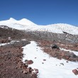 Stock Photo: Peak Elbrus, snow and stones in Caucasus mountains