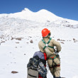 Stock Photo: Climber in mountains against peak Elbrus, glaciers