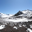 Стоковое фото: Rocks, snow, stones and sky in Caucasus mountains
