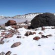 Stok fotoğraf: Stones, rocks, snow and mountain lake, Caucasus.