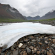 Stock Photo: White ice on stones.Saymountain valley.Russia.Siberia.