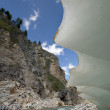 Постер, плакат: Fantastic ice shape near mountain river and rocks