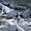 Water stream flowing among stones and rocks. — Stock Photo