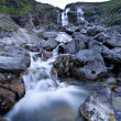 Water stream of mountain river flowing from rocks. — Stock Photo #4140493