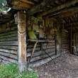 Royalty-Free Stock Photo: Wood hut in taiga with national symbols and images