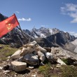 Stock Photo: Red USSR flag at top of mountain among stones