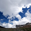 Beautiful white clouds,blue sky.Caucasus mountains — Stock Photo