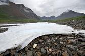 White ice on stones.Sayan mountain valley.Russia.Siberia. — Stock Photo
